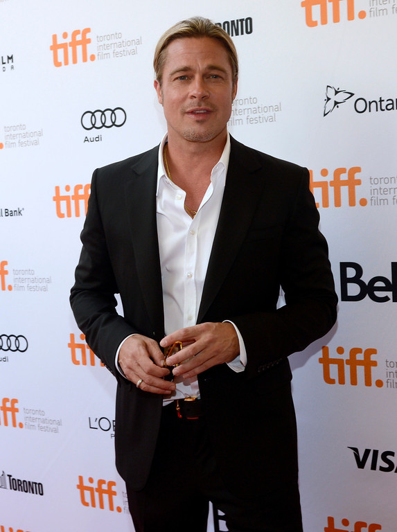 ". Brad Pitt arrives at the premiere for ""12 Years a Slave\"" on day 2 of the Toronto International Film Festival at The Princess of Wales Theatre on Friday, Sept. 6, 2013, in Toronto. (Photo by Chris Pizzelloi/Invision/AP)"