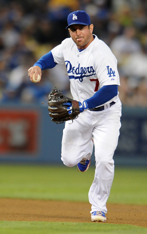 . Nick Punto picks up a grounder in the 4th inning. The Dodgers played the New York Mets in a game at Dodger Stadium in Los Angeles, CA. 8/13/2013(John McCoy/LA Daily News)