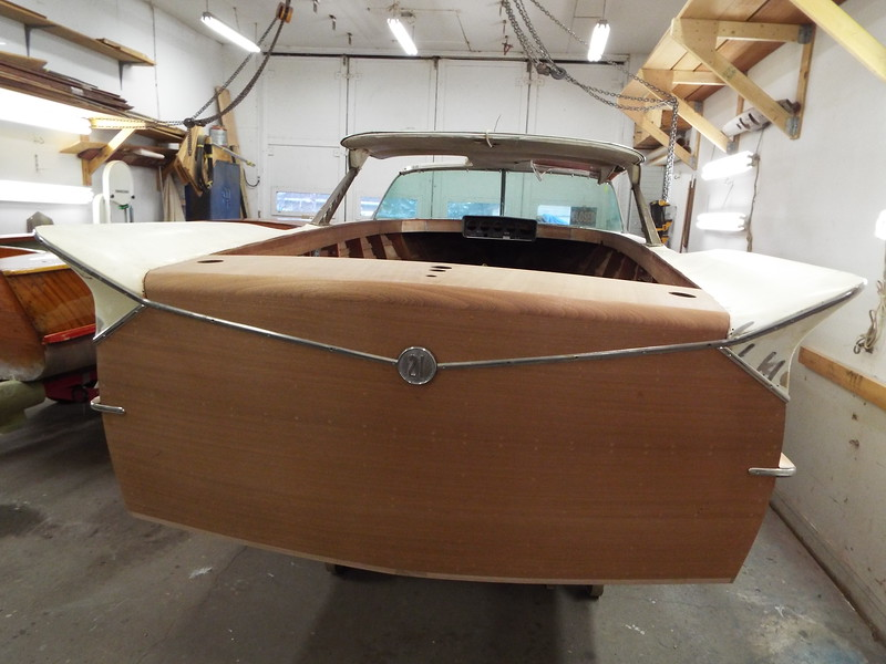 Stainless trim and logo installed on the transom.