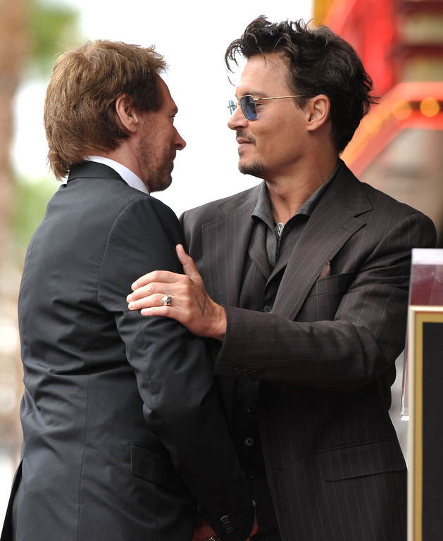 . Johnny Depp, right, embraces Jerry Bruckheimer at a ceremony honoring Bruckheimer with a star on the Hollywood Walk of Fame on Monday, June 24, 2013 in Los Angeles. (Photo by John Shearer/Invision/AP)