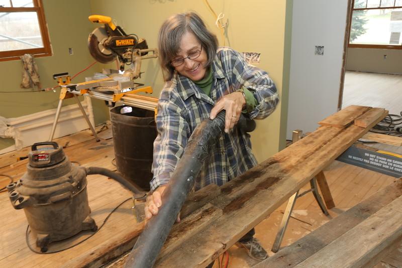 Carol Troyer-Shank cleans the maple flooring refurbishing station - Dec 2nd 2016