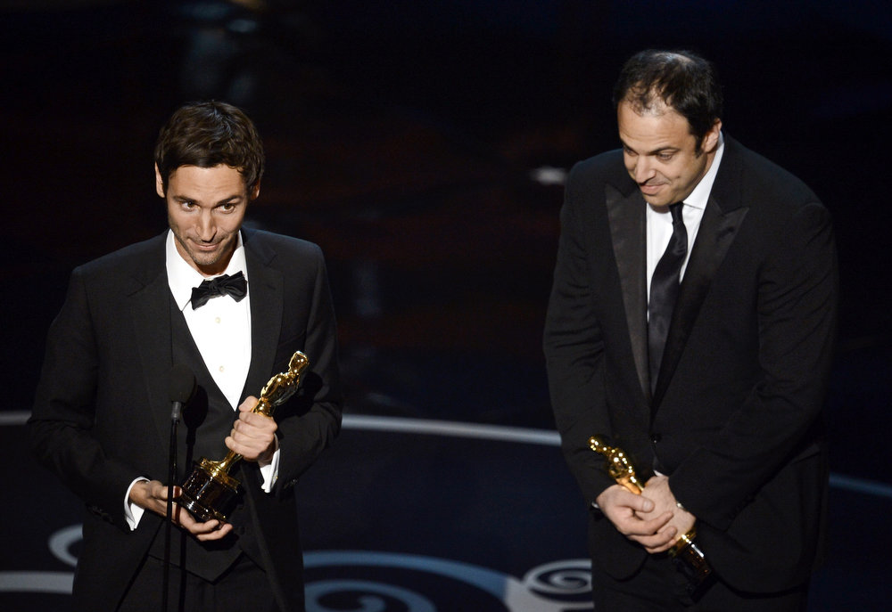 ". Filmmakers Malik Bendjelloul and Simon Chinn accept the Best Documentary - Feature award for ""Searching for Sugar Man\"" onstage during the Oscars held at the Dolby Theatre on February 24, 2013 in Hollywood, California.  (Photo by Kevin Winter/Getty Images)"