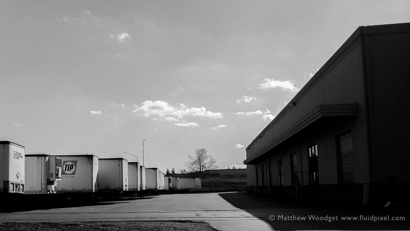 Woodget-130309-002--black and white, shipping, sky, stark, transportation - OCCUPATION, truck, warehouse.jpg