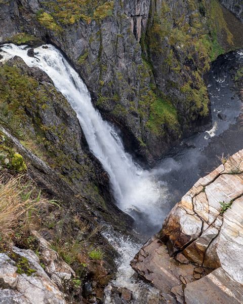 Vøringfossen is the 83rd highest waterfall in Norway on the basis of total fall. It lies at the top of Måbødalen in the municipality of Eidfjord, in Hordaland, not far from Highway 7, which connects Oslo with Bergen. It has a total drop of 182 meters, and a major drop of 163 meters. It is perhaps the most famous in the country and a major tourist attraction on the way down from Hardangervidda to Hardangerfjord. Wikipedia