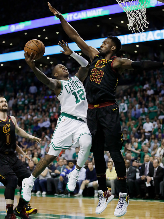 . Boston Celtics guard Terry Rozier (12) goes to the basket against Cleveland Cavaliers forward Jeff Green (32) during the fourth quarter of Game 5 of the NBA basketball Eastern Conference finals Wednesday, May 23, 2018, in Boston. (AP Photo/Charles Krupa)