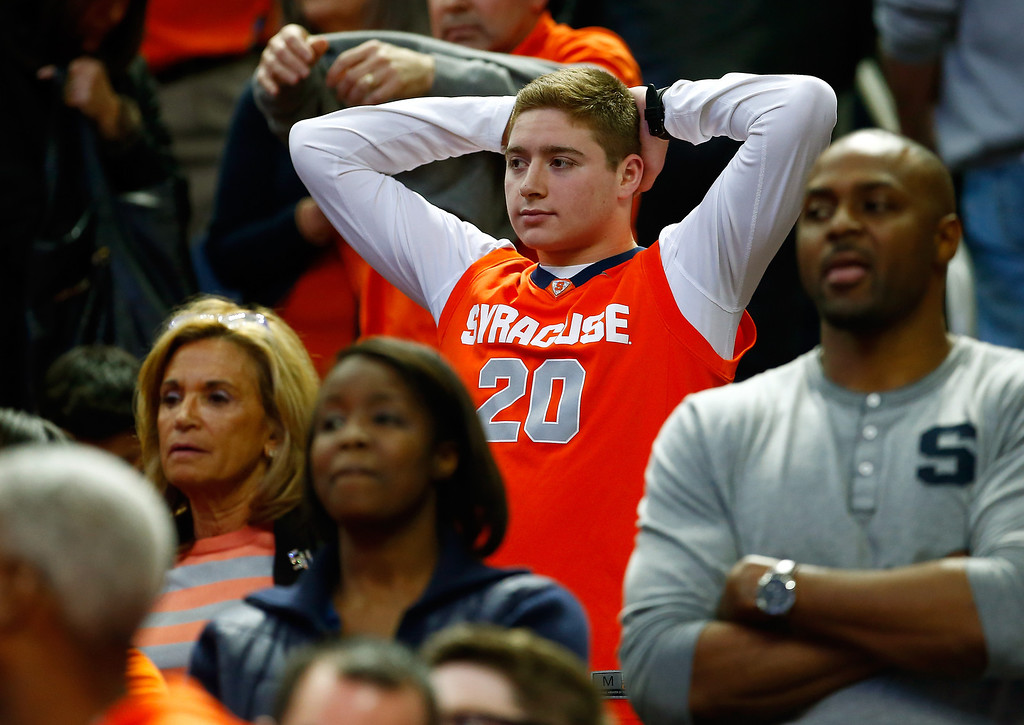 . BUFFALO, NY - MARCH 22: A Syracuse Orange fan looks on during the third round of the 2014 NCAA Men\'s Basketball Tournament between the Syracuse Orange and the Dayton Flyers at the First Niagara Center on March 22, 2014 in Buffalo, New York.  (Photo by Jared Wickerham/Getty Images)