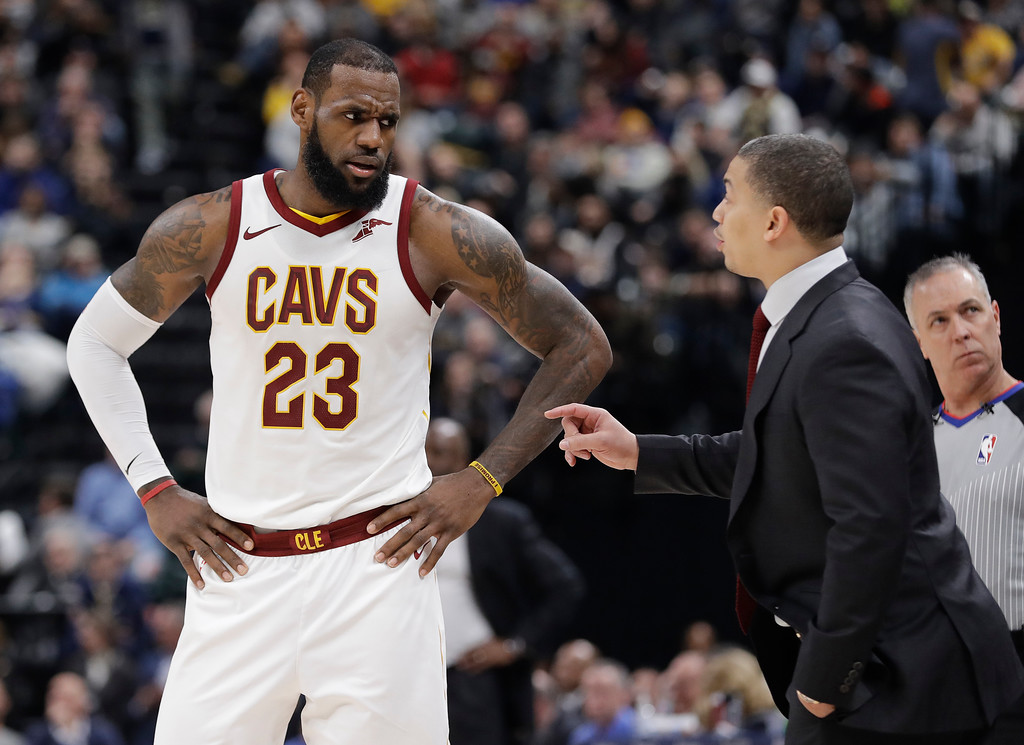 . Cleveland Cavaliers head coach Tyronn Lue, front right, talks with LeBron James during the second half of an NBA basketball game against the Indiana Pacers, Friday, Jan. 12, 2018, in Indianapolis. (AP Photo/Darron Cummings)