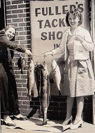 """. UNNAMED CO-CONSPIRATOR: \""""My amazing aunt, Jean Litman, will celebrate her 100th birthday on June 6th. She is just as lively and stylish as she was more than 70 years ago, when she apparently went fishing wearing a dress and snazzy pumps. That\'s Jean and her sister/my mother, Esther Ruder, showing off their catch at a bait store in Park Rapids. (Jean\'s husband Aaron was your paper\'s Outdoor Editor about that time. Since everyone looks happy, I don\'t think this was the fishing trip when my mom knocked his tackle box overboard.\"""""""
