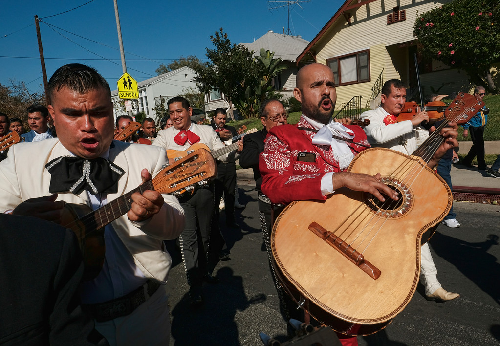 . Mariachis play in the street during the Santa Cecilia procession in the Boyle Heights section of Los Angeles on Tuesday, Nov. 22, 2016. Musicians from around the country gathered for Mariachi Sol de Mexico to celebrate Santa Cecilia. The festival honors Santa Cecilia the patron saint of musicians. (AP Photo/Richard Vogel)
