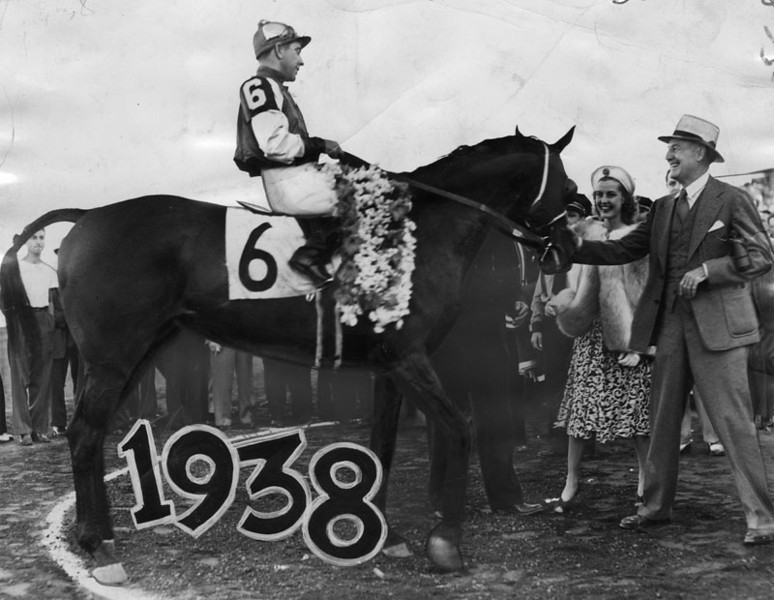 . Seabiscuit is shown in the winner\'s circle after winning the initial running of the $50,000 Hollywood Gold Cup race on July 18, 1938. George Woolf is the jockey, with his owner, Charles S. Howard, and Anita Louise paying homage to the great champ.   (Los Angeles Public Library)