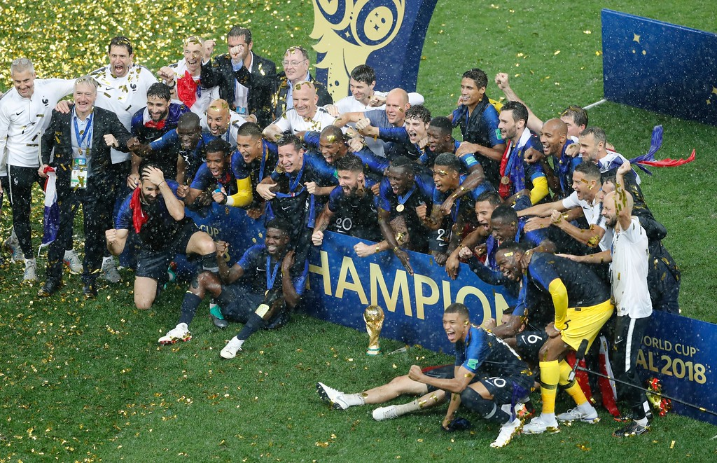 . French players celebrate with the trophy at the end of the final match between France and Croatia at the 2018 soccer World Cup in the Luzhniki Stadium in Moscow, Russia, Sunday, July 15, 2018. (AP Photo/Frank Augstein)