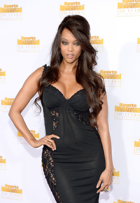 . Model and Tv Personality Tyra Banks attends NBC and Time Inc. celebrate the 50th anniversary of the Sports Illustrated Swimsuit Issue at Dolby Theatre on January 14, 2014 in Hollywood, California.  (Photo by Dimitrios Kambouris/Getty Images)