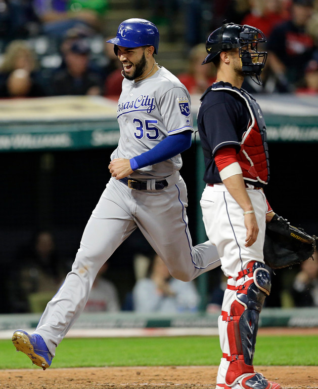 . Kansas City Royals\' Eric Hosmer, left, scores as Cleveland Indians catcher Yan Gomes waits in the eighth inning of a baseball game, Friday, May 26, 2017, in Cleveland. Hosmer scored on a two-run double by Jorge Bonifacio. (AP Photo/Tony Dejak)