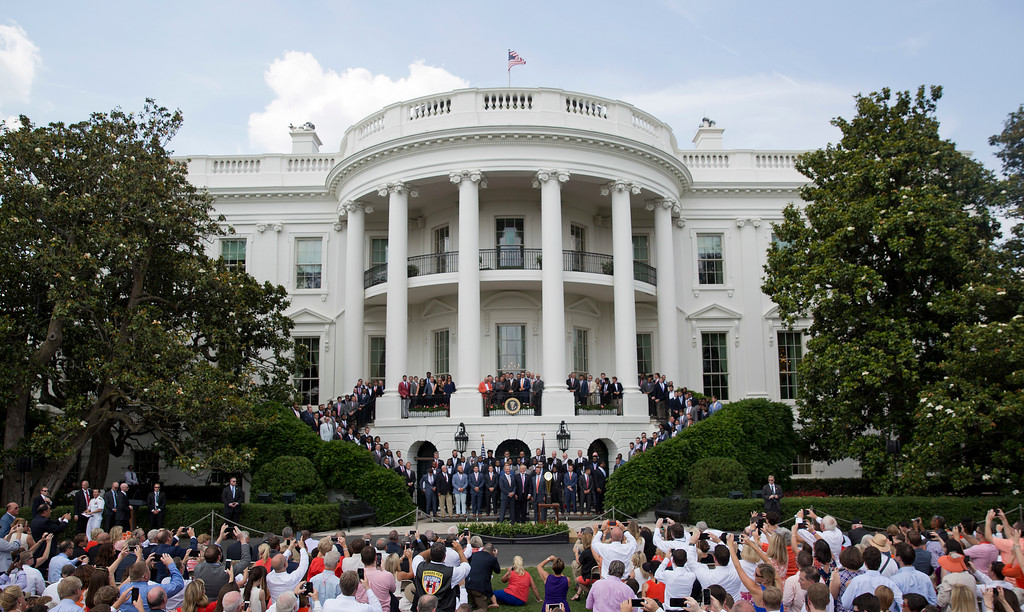 . President Donald Trump poses for a group photo as he welcomed the 2016 NCAA Football National Champions Clemson University Tigers, Monday, June 12, 2017, during a ceremony on the South Lawn of the White House in Washington. (AP Photo/Pablo Martinez Monsivais)