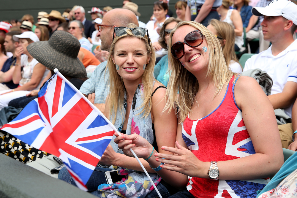 . Spectators pose before Laura Robson of Great Britain\'s Ladies\' Singles fourth round match against Kaia Kanepi of Estonia on day seven of the Wimbledon Lawn Tennis Championships at the All England Lawn Tennis and Croquet Club on July 1, 2013 in London, England.  (Photo by Clive Brunskill/Getty Images)