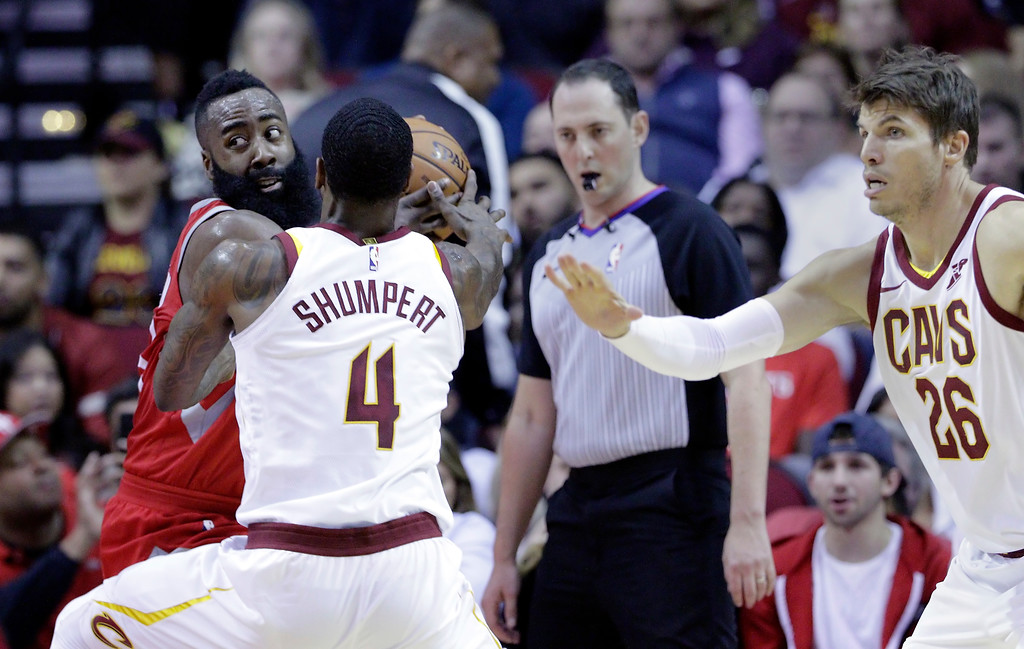 . Houston Rockets guard James Harden (13) pulls the ball away from Cleveland Cavaliers guard Iman Shumpert (4) as Cavaliers guard Kyle Korver (26) watches during the first half of an NBA basketball game Thursday, Nov. 9, 2017, in Houston. (AP Photo/Michael Wyke)