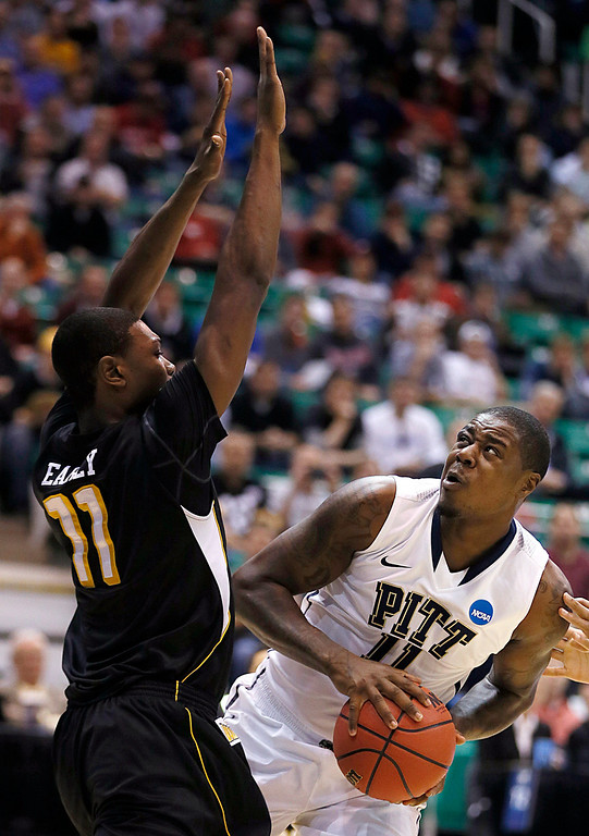 . Pittsburgh\'s Dante Taylor, right, looks to shoots over Wichita State Cleanthony Early during a second-round game in the NCAA college basketball tournament in Salt Lake City Thursday, March 21, 2013. (AP Photo/George Frey)