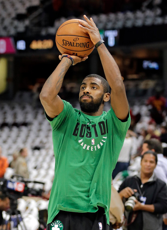 . Boston Celtics\' Kyrie Irving warms up before an NBA basketball game between the Celtics and the Cleveland Cavaliers, Tuesday, Oct. 17, 2017, in Cleveland. (AP Photo/Tony Dejak)
