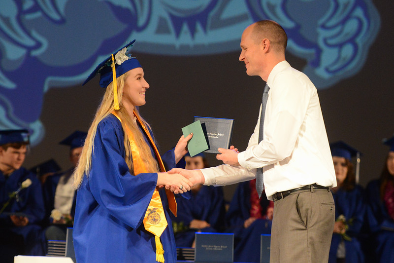 Matthew Harvey presents Mallory Lavy with her diploma, May 24, 2018,  in Chico, California. (Carin Dorghalli -- Enterprise-Record)