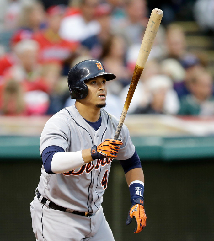 . Detroit Tigers\' Victor Martinez watches his ball after hitting a two-run home run off Cleveland Indians starting pitcher Corey Kluber in the fourth inning of a baseball game on Friday, June 20, 2014, in Cleveland. Tigers\' Miguel Cabrera also scored. (AP Photo/Tony Dejak)