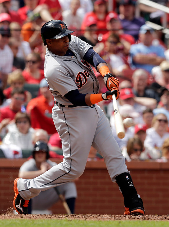 . Detroit Tigers\' Yoenis Cespedes hits an RBI single during the third inning of a baseball game against the St. Louis Cardinals, Saturday, May 16, 2015, in St. Louis. (AP Photo/Jeff Roberson)