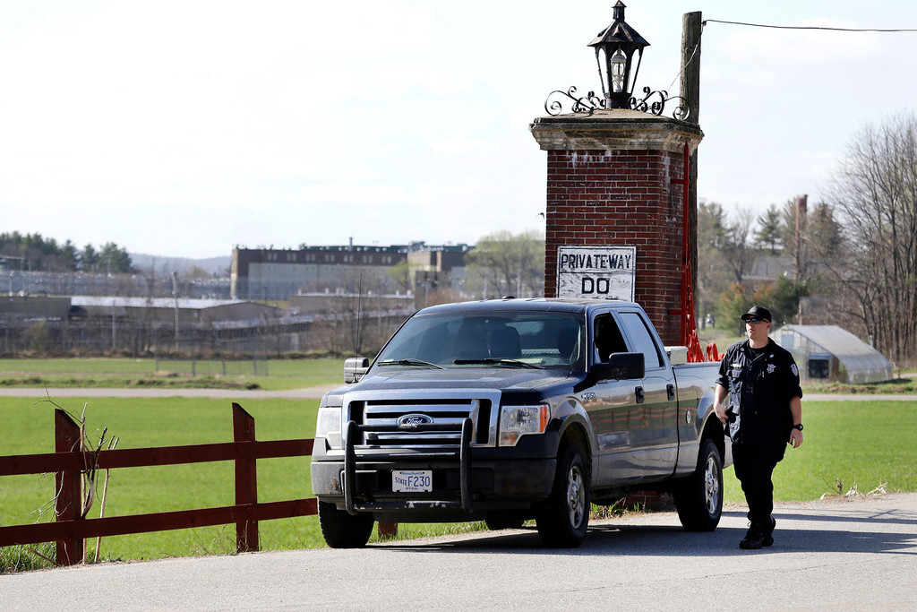 . A policeman guards an entrance to the Souza-Baranowski Correctional Center, Wednesday, April 19, 2017, in Shirley, Mass. Former NFL star Aaron Hernandez, who was serving a life sentence for a murder conviction and just days ago was acquitted of a double murder, died after hanging himself at the prison early Wednesday, Massachusetts prisons officials said. (AP Photo/Elise Amendola)