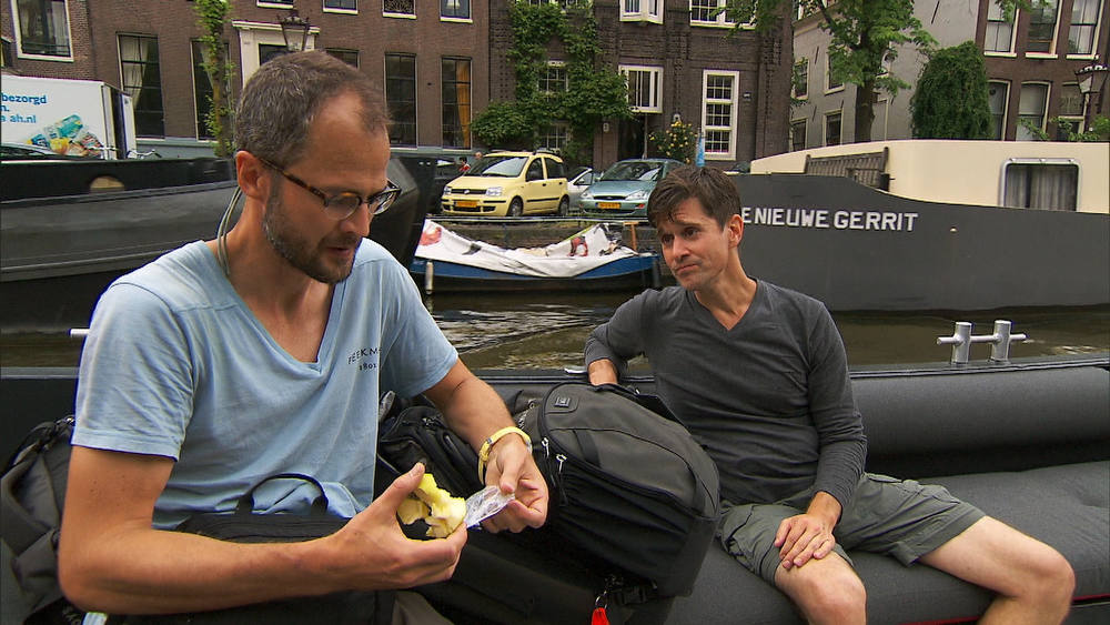 ". ""Fishy Kiss (Amsterdam, Netherlands)\""--Goat Farmers/Life Partners Josh (left) and Brent (right) travel by boat to receive the next clue on THE AMAZING RACE on the CBS Television Network. Photo: CBS ©2012 CBS Broadcasting, Inc. All Rights Reserved"