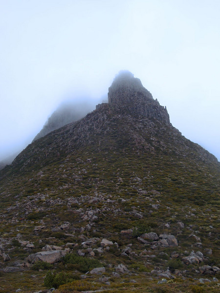 At the end of the plateau, the mountain awaited us. We eyed it's clouded summit with concern.