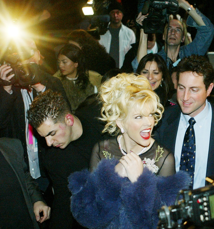 . ** RETRANSMITTING TO CORRECT DATE TO MONDAY **Anna Nicole Smith leaves after the Betsey Johnson fashion show Monday, Feb. 9, 2004, in New York. (AP Photo/Kathy Willens)