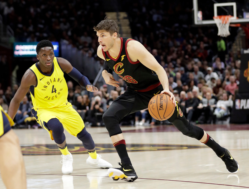 . Cleveland Cavaliers\' Kyle Korver (26) drives against Indiana Pacers\' Victor Oladipo (4) in the first half of Game 1 of an NBA basketball first-round playoff series, Sunday, April 15, 2018, in Cleveland. (AP Photo/Tony Dejak)