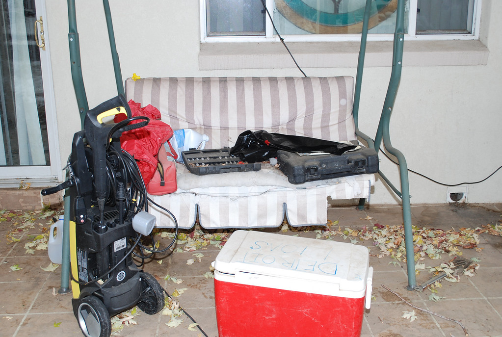 . A swing and empty bleach bottle in the backyard of Austin Sigg\'s home. Provided by Jefferson County District Attorney\'s Office