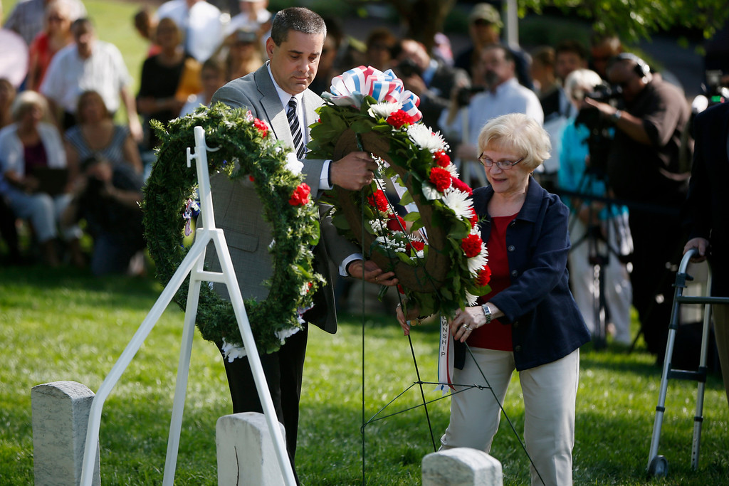 . Relatives of Army Pvt. William Christman, who was the first military burial at the cemetery, James Christman, great-grand nephew, left, of Allentown, Pa., and Barbara Christman Page, great-grand niece, of Swiftwater, Pa., place a wreath at his grave marking the beginning of commemorations of the 150th anniversary of Arlington National Cemetery in Arlington, Va., Tuesday, May 13, 2014. Christman, 20, enlisted in the 67th Pennsylvania Infantry and was hospitalized for measles five weeks later, dying on May 11, 1864 and buried at Arlington on May 13. (AP Photo)