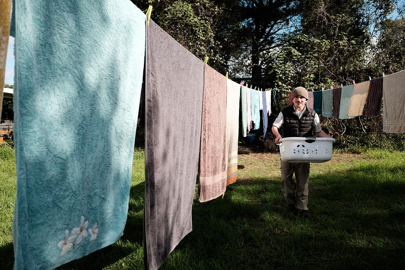 Man with a Washing Basket at a Clothes Line