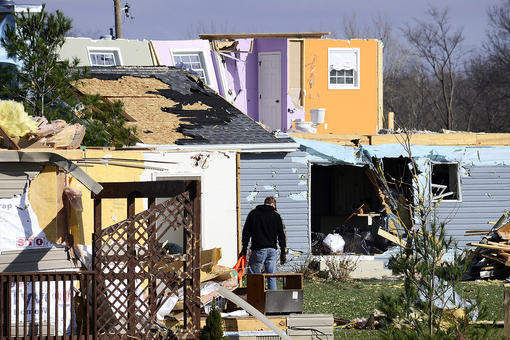 . Residents comb through the wreckage of their storm-damaged homes on Tuesday, Nov. 19, 2013, south of Jalapa, Ind. The National Weather Service said Tuesday that at least 26 tornadoes touched down Sunday in Indiana, making it the second-biggest tornado outbreak in state history. Meteorologist John Kwiatkowski said the state\'s most active tornado day was June 2, 1990, when 33 tornadoes touched down.  (AP Photo/The Chronicle-Tribune, Jeff Morehead)