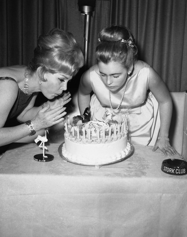 . Zsa Zsa Gabor gives her daughter Francesca Hilton an assist as she celebrates her 16th birthday in the cub room of New York\'s Stork Club on March 9, 1963.      Approximately one hundred socially prominent guests attended the affair.  (AP Photo)