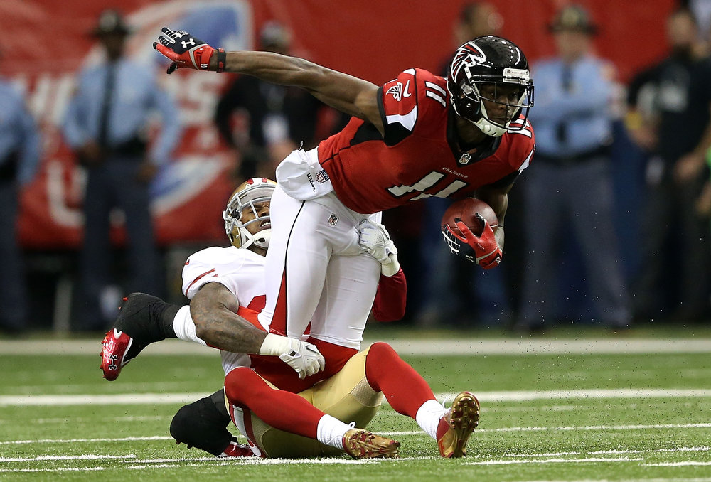 Description of . Wide receiver Julio Jones #11 of the Atlanta Falcons runs after a catch in the first half against the San Francisco 49ers in the NFC Championship game at the Georgia Dome on January 20, 2013 in Atlanta, Georgia.  (Photo by Streeter Lecka/Getty Images)