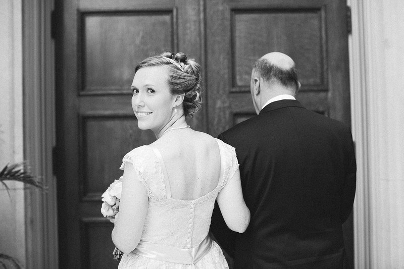 bride with father before walking down aisle