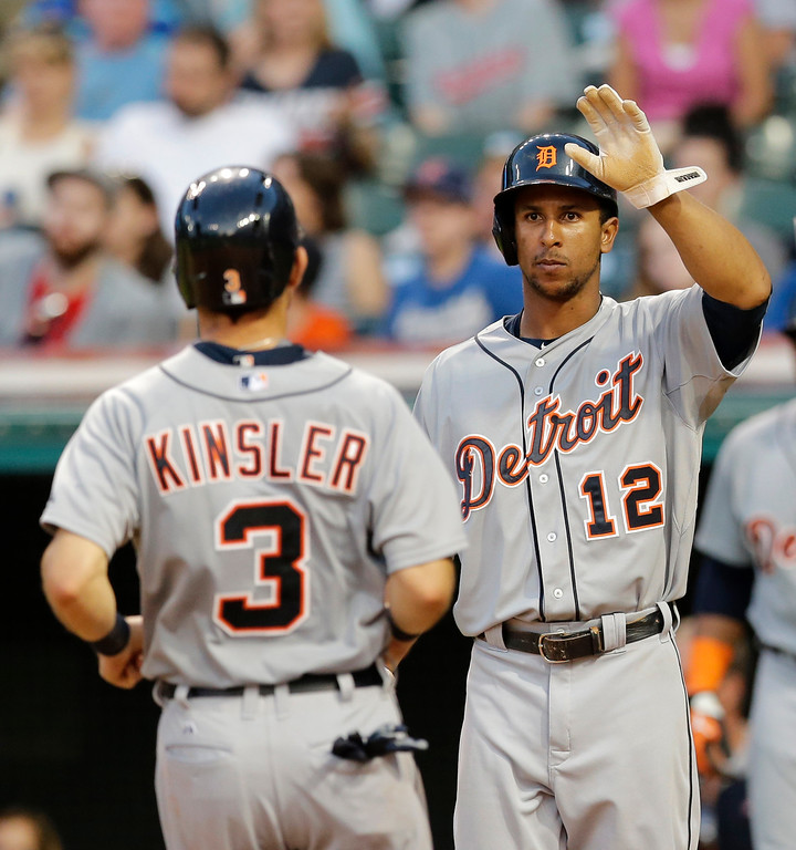 . Detroit Tigers\' Anthony Gose (12) and Ian Kinsler (3) celebrate after both score on a two-RBI single by Victor Martinez in the fourth inning of a baseball game against the Cleveland Indians, Monday, June 22, 2015, in Cleveland. (AP Photo/Tony Dejak)