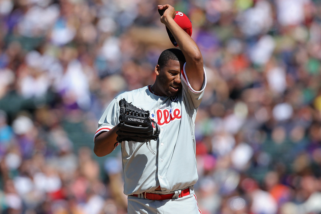 . Starting pitcher Roberto Hernandez #27 of the Philadelphia Phillies pauses between batters as he works against the Colorado Rockies at Coors Field on April 20, 2014 in Denver, Colorado.  (Photo by Doug Pensinger/Getty Images)