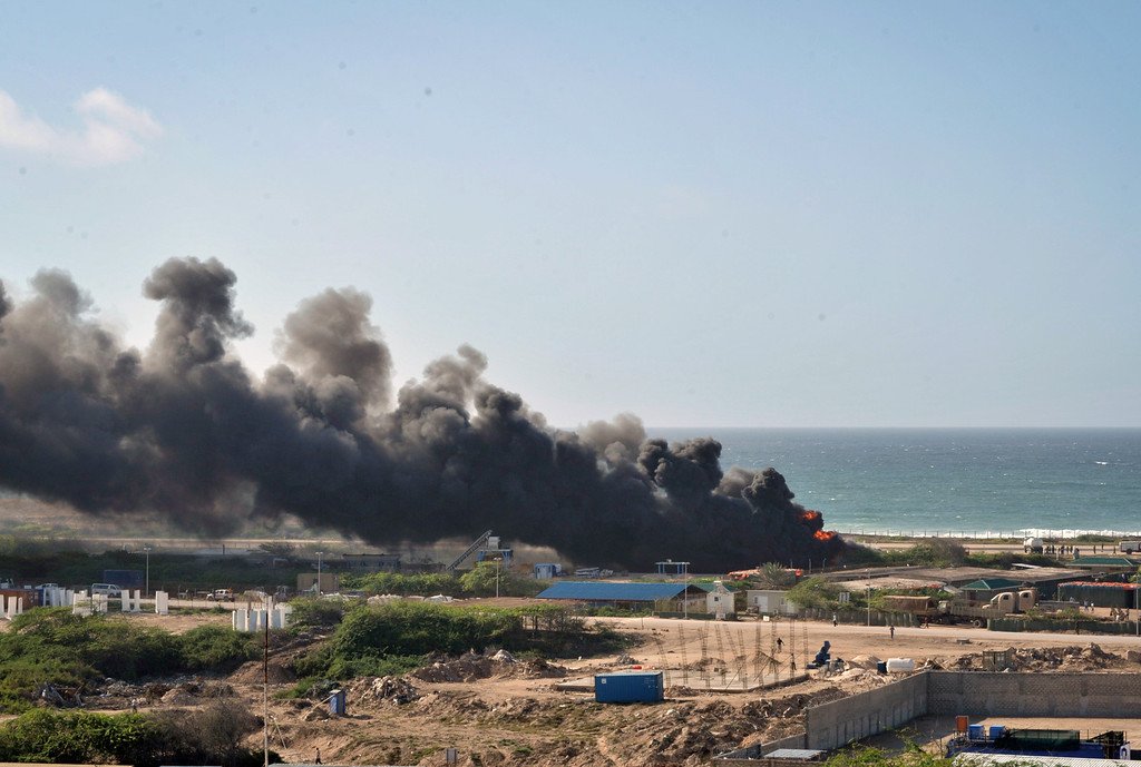 . In this handout photo released by African Union Mission in Somalia (AMISOM), AMISOM ,Black smoke rises as airplane crashed in Mogadishu, Somalia, Friday, Aug. 9. 2013. (AP Photo/Tobin Jones, AU/UN IST, AMISOM)