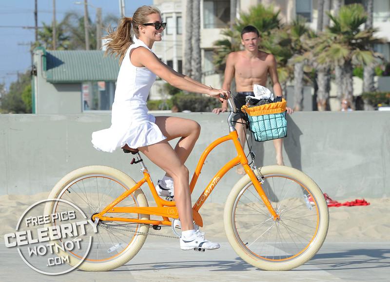 EXC: AnnaLynne McCord In Short Tennis Outfit Riding Beach Cruiser