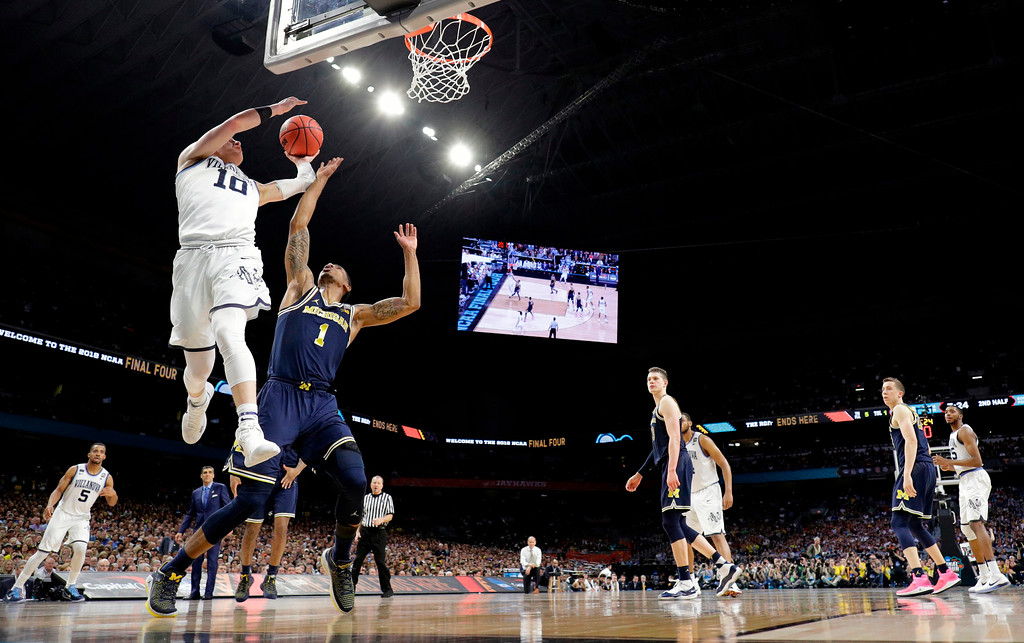 . Villanova\'s Donte DiVincenzo (10) goes up for a shot over Michigan\'s Charles Matthews (1) during the second half in the championship game of the Final Four NCAA college basketball tournament, Monday, April 2, 2018, in San Antonio. (AP Photo/David J. Phillip)