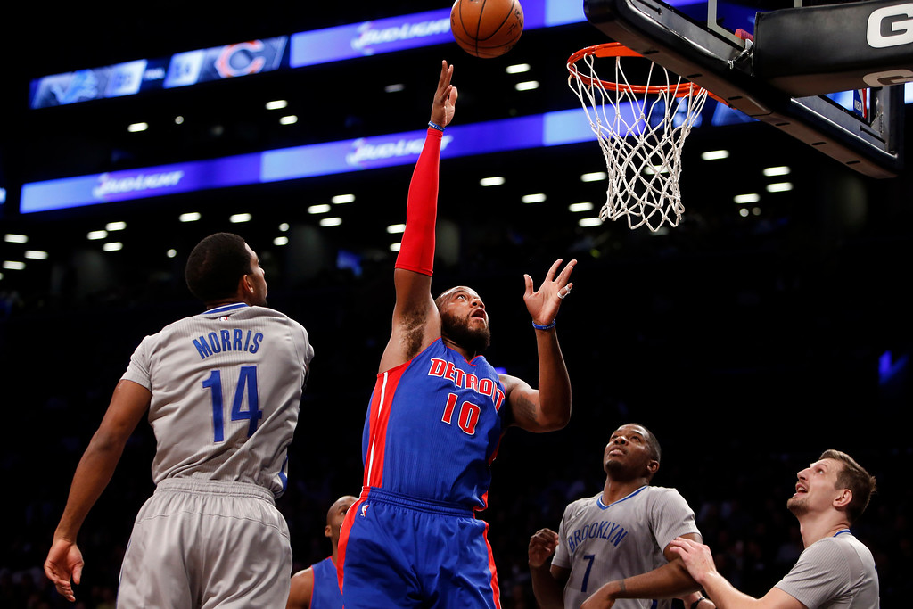 . Detroit Pistons\' Greg Monroe (10) shoots against the Brooklyn Nets during the first quarter of an NBA basketball game Sunday, Dec. 21, 2014, in New York. (AP Photo/Jason DeCrow)