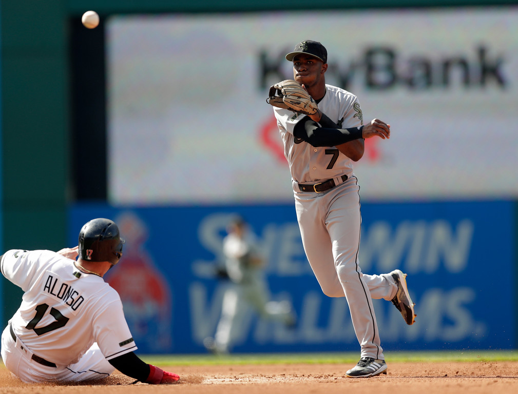 . Chicago White Sox\'s Tim Anderson (7) gets Cleveland Indians\' Yonder Alonso (17) out at second base in the second inning of a baseball game, Monday, May 28, 2018, in Cleveland. Melky Cabrera was out at first base for the double play. (AP Photo/Tony Dejak)