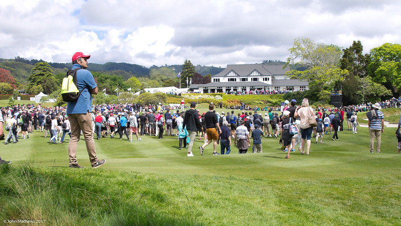 View of the clubhouse and crowds as seen by fans on the 18th green with the final group of players on the last day of the Asia-Pacific Amateur Championship tournament 2017 held at Royal Wellington Golf Club, in Heretaunga, Upper Hutt, New Zealand from 26 - 29 October 2017. Copyright John Mathews 2017.   www.megasportmedia.co.nz