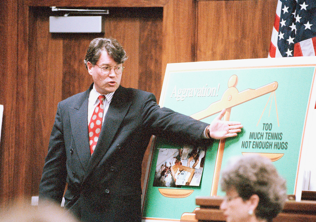 . Prosecutor David Conn points to a poster during his closing argument in the penalty phase of the trial of Lyle and Erik Menendez on Thursday, April 11, 1996 in the Van Nuys section of Los Angeles. Conn urged jurors to sentence the brothers to death for the 1989 murders of their millionaire parents. (AP Photo/Nick Ut)
