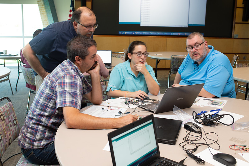 Judd Curtis (left), Michael S. Williamson, Hannah Ehrmann, and Michael Van Den Eijnden at the Microcontrollers Workshop at the Harte Research Institute.