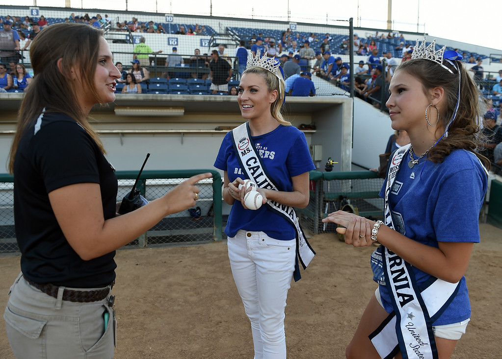 . Ms. California 2014 Sande Charles, center and Ms. Jr. Teen California Alina Carranza prepare to throw out the first pitches at the Quakes game at LoanMart Field in Rancho Cucamonga, CA, Friday, August 15, 2014. (Photo by Jennifer Cappuccio Maher/Inland Valley Daily Bulletin)
