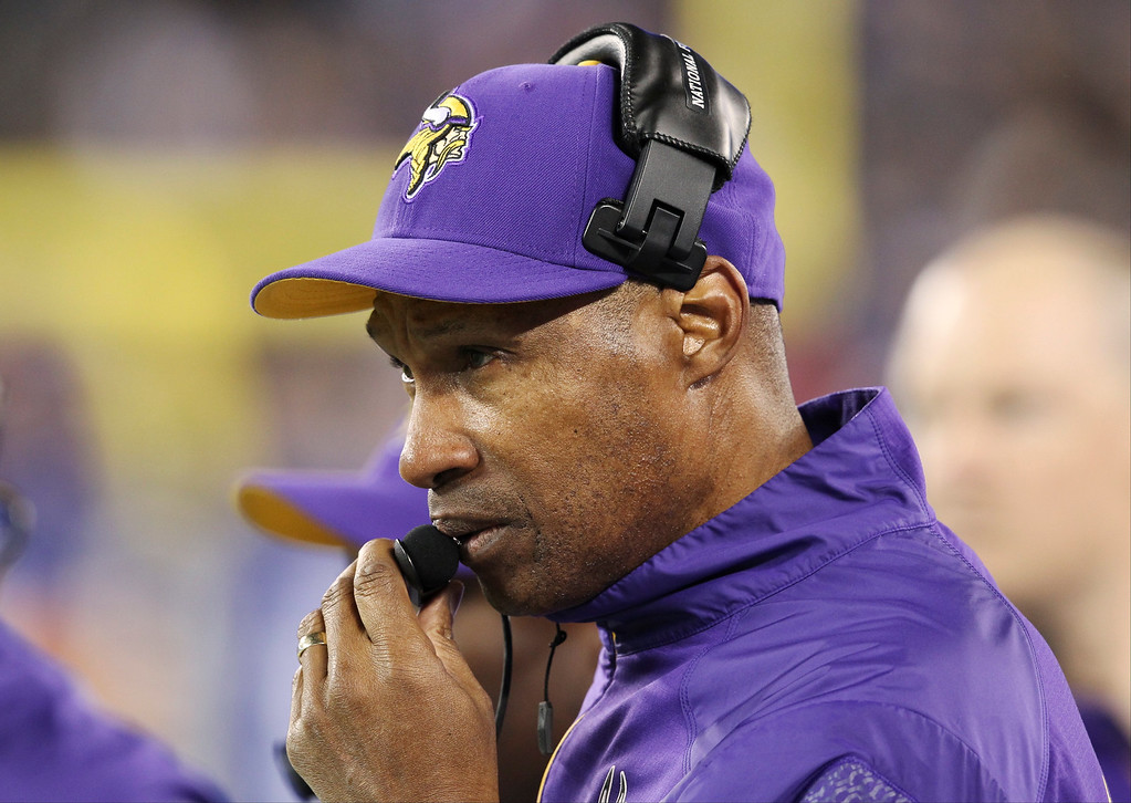 . Minnesota Vikings head coach Leslie Frazier talks into his headset during the first half of an NFL football game against the New York Giants Monday, Oct. 21, 2013 in East Rutherford, N.J. (AP Photo/Peter Morgan)