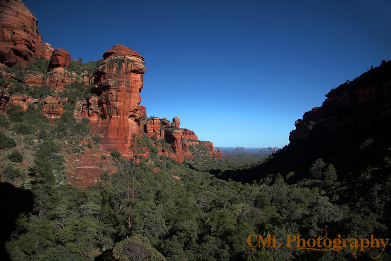 An HDR composite.  The view from Fay Canyon.  You can see Courthouse Butte and Bell Rock way in the distance.